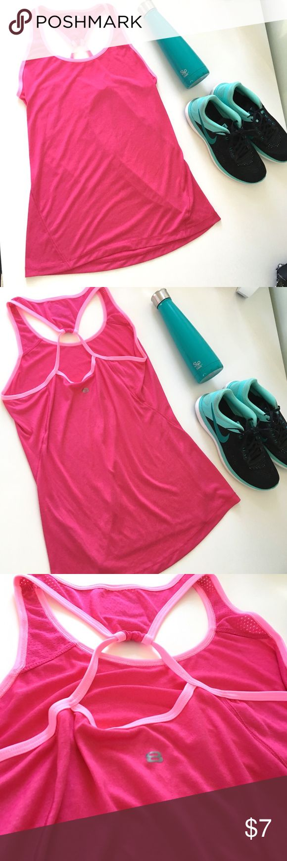 Hot Pink Strappy Workout Tank This hot pink workout tank features light pink contrast piping and a cute strappy back that shows off your sports bra! Worn and laundered once, and in excellent condition. Bundle with my other workout items to save on your next gym outfit! Hope you love your new tank! Layer 8 Performance Tops Tank Tops