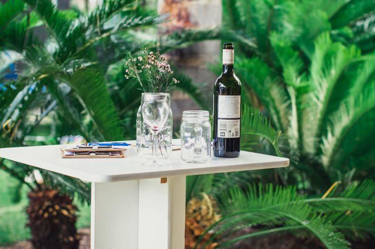 White standing tables, mason jar flowers, mason jar mug, mini clip boards