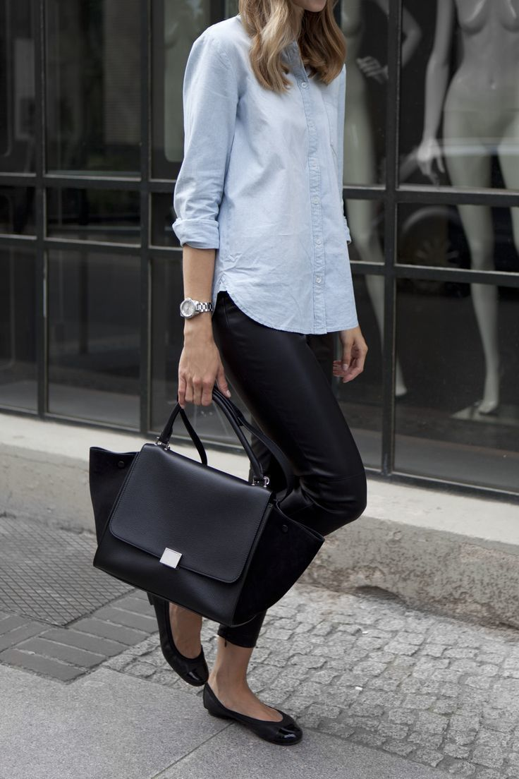 Shop this look on Lookastic:  https://lookastic.com/women/looks/dress-shirt-leggings-ballerina-shoes-satchel-bag-watch/13430  — Light Blue Chambray Dress Shirt  — Silver Watch  — Black Leather Leggings  — Black Leather Satchel Bag  — Black Leather Ballerina Shoes