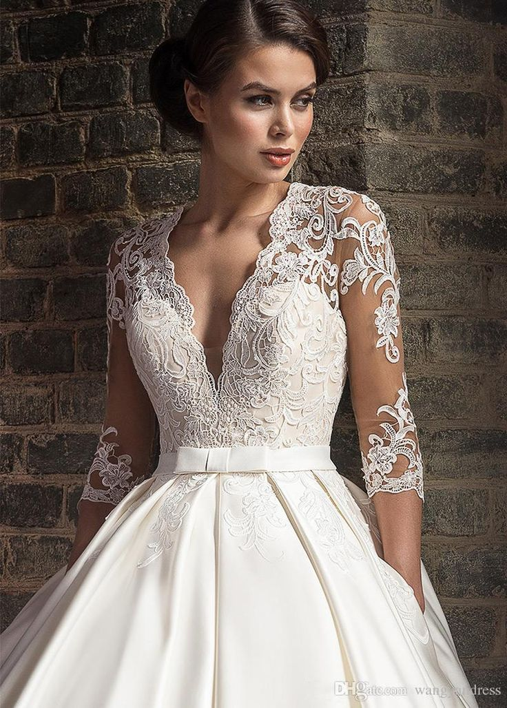 2018 Vintage White Applique Lace Wedding Dresses With 3/4 Long Sleeves Sexy Illusion Deep V-neck Bridal Gowns Simple A-line Wedding Dress