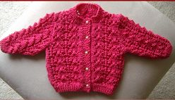 Knitting pattern for lacy jacket for baby.