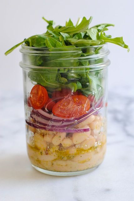 White Bean Salad Jars - A light and fresh lunch to get you through the work week. Layers of marinated cannellini beans, grape tomatoes, red onion and peppery arugula.   foxeslovelemons.com