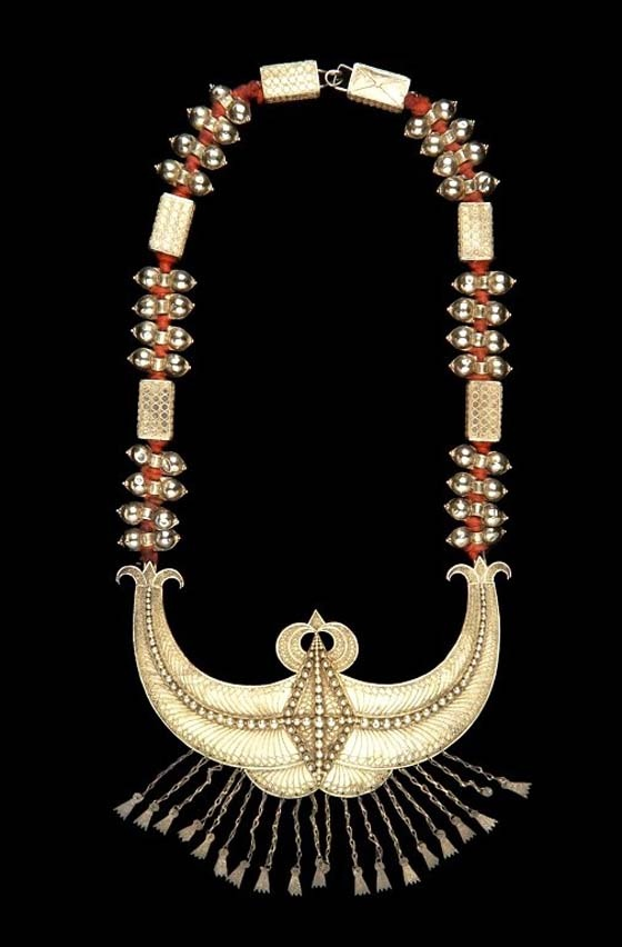 Indonesia ~ Great Sunda Islands region | Necklace worn by a Karo Batak (Sumatera) bride on her wedding day | Gilded silver and braided red cloth |  The main pendant represent the traditional Adat karo house and water buffalo horns indicating high social rank and prestige.