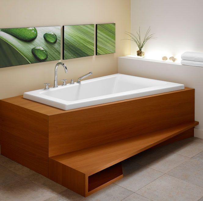 BORA A Modern Corner Bathtub With A Very Comfortable Curved Backrest.