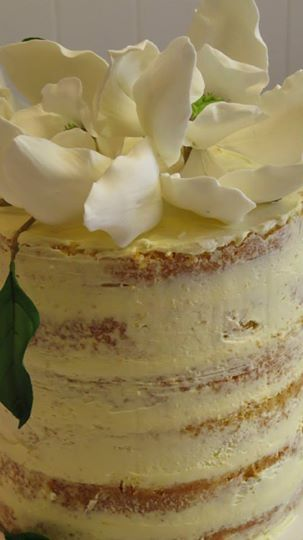 6 Layers of Almond lemon cake with Limoncello cream cheese icing - special cake for the opening of a new shop