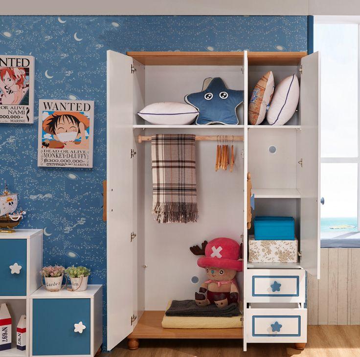 Открытые двери и ящики у детского шкафа в морском стиле