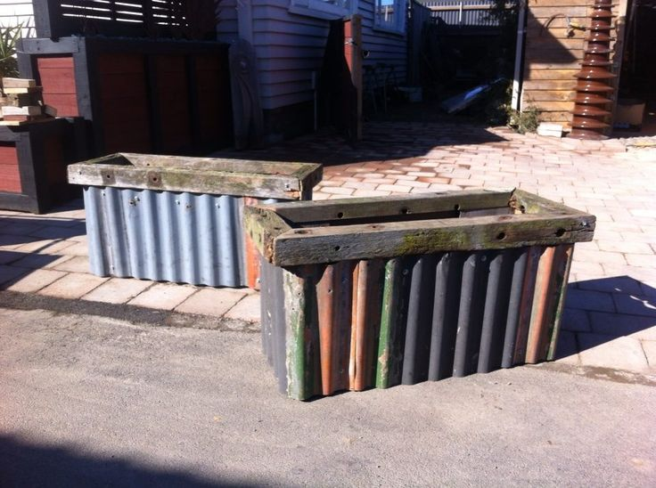 Rustic outdoor planter boxes, old weathered corrugated iron and wood