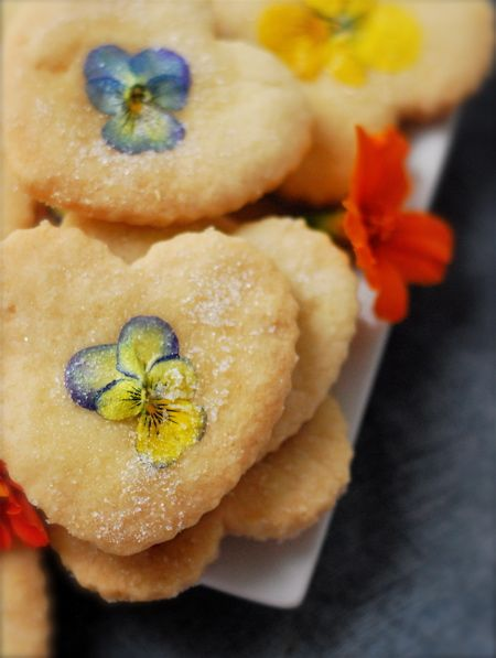 shortbread with flower blossoms   via Living the Blue Collar Way  ~2 cups unsalted butter at room temperature  2/3 cup granulated sugar  4 cups pastry flour  1 and 1/3 cups cornstarch(?)  edible flowers  egg whites  superfine sugar