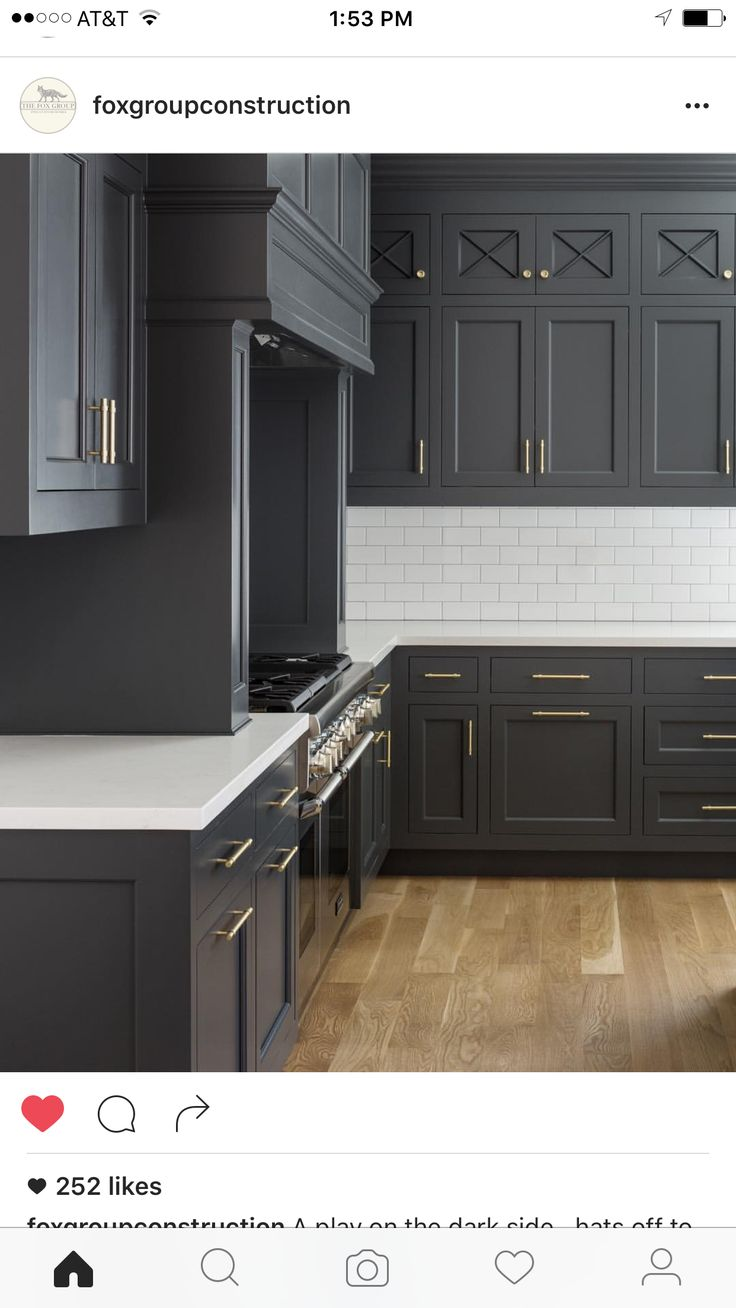 Benjamin Moore Cheating Heart on dark almost black kitchen cabinets with white countertop and wood flooring