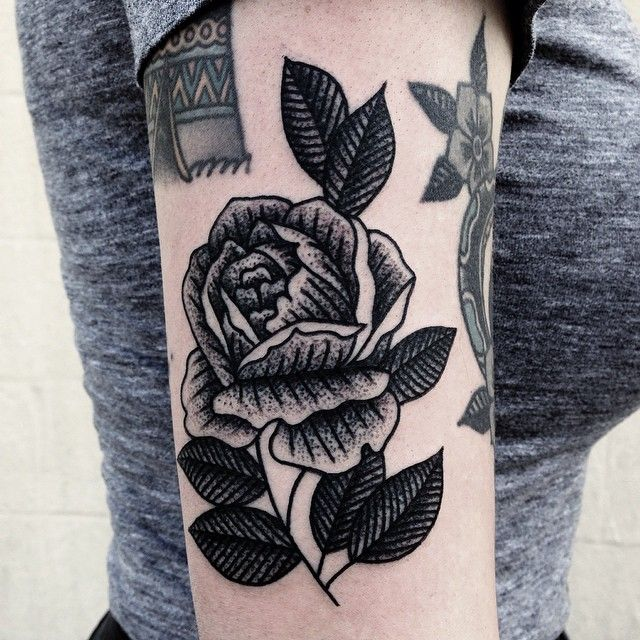 Mike adams rose tattoo