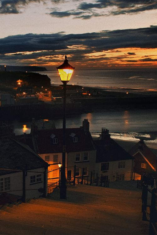 Whitby at night, steps from Whitby Abbey down to the sea, UK