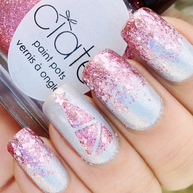 Shimmery white mani with pink gradient glitter tips and a Christmas tree accent nail