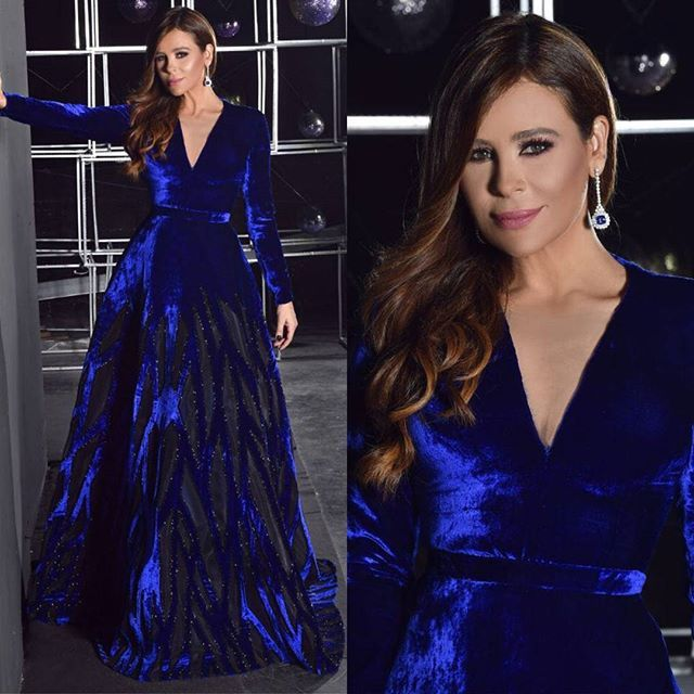 the #christmas duet as the Grande Finale of @celebrityduetstv on @mtvlebanon Styled by: @ma.fashionconsultancy  Dress by: @aliyounescouture  Jewelry: @azargems  Hair: @tonyibrahimofficial  Makeup: @paulconstantinian  Photography: @zobiansaadofficial