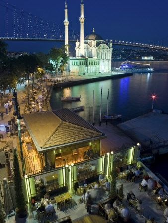ORTAKÖY at night. the streets are lined with restaurants, night clubs & bars, and shops. ortaköy, istanbul turkey.