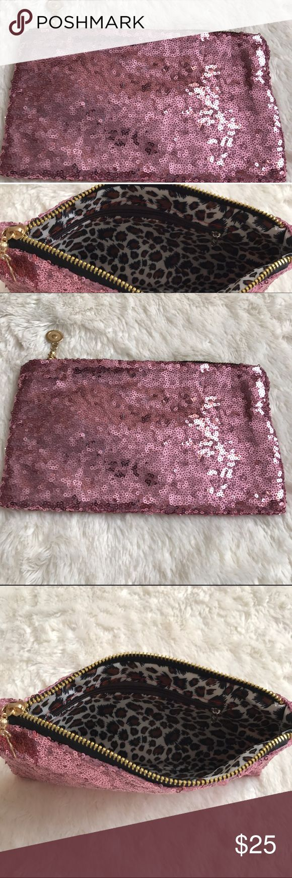 Pink Mauve Sequin Clutch THIS LISTING IS FOR THE PINK MAUVE CLUTCH ONLY * Stumped on what to wear with your next outfit? You'll never need to buy another clutch again! The inside has a beautiful leopard print fabric with an zipper pocket for more storage. External zipper is gold with a small decorative tab  MATERIALS: Lining: Polyester External: Sequins/Polyester   P U R P O S E S: -Bachelorette Party Gift/Favor -Bridal Party Gift -Bridal Shower Gift/Favor -Wedding Guest Clutch -Everyday…