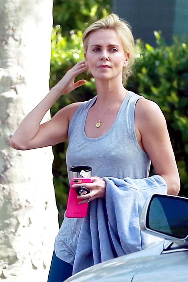 Charlize Theron hot and sexy workout casual in a grey tank top braless with  pokie nipples