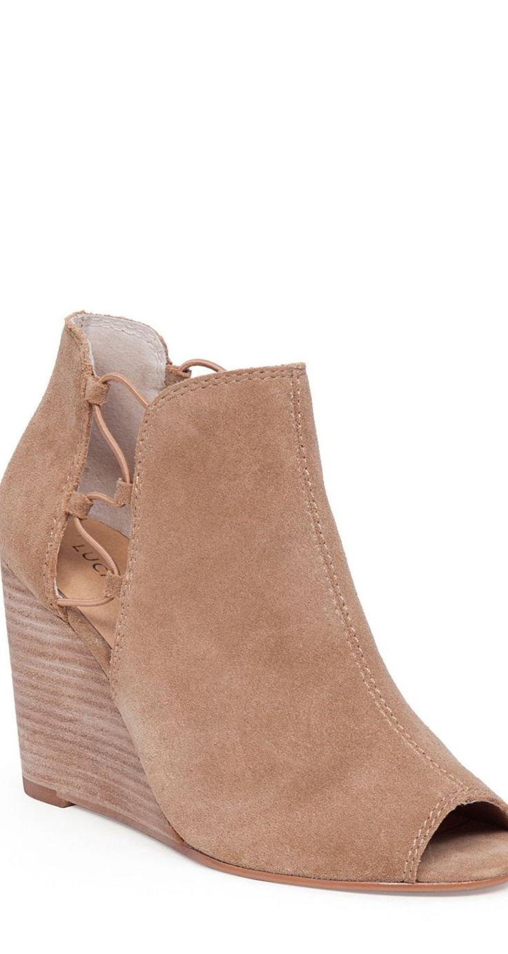 Modern bohemian style is yours in these peep toe wedge booties from Lucky  Brand.