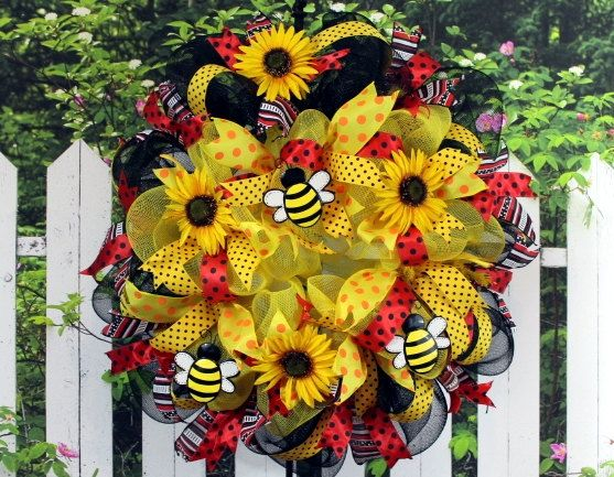 "Deco Mesh Wreath in Yellow and Black, Bumble Bee, Sunflowers, Lots of Ribbon 30 "". $58.95, via Etsy."