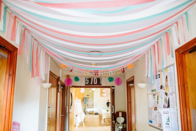 Ribbon Crepe Paper Hanging Ceiling Decor Pretty Quirky DIY Village Hall Wedding http://lauradebourdephotography.com/