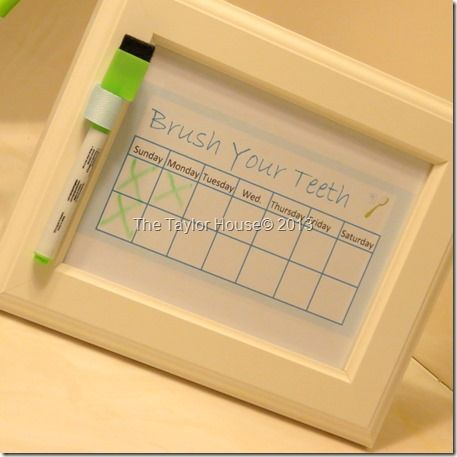 """Printable """"Brushing Teeth"""" Chart for Kids...double picture frame w/ picture of child wrapped in a towel on top, brush teeth chart below, hanging above a hook with child's towel in the bathroom!"""