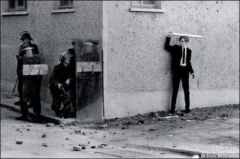 Don McCullin - A Catholic youth and British soldiers in Bogside, Northern Ireland in 1971