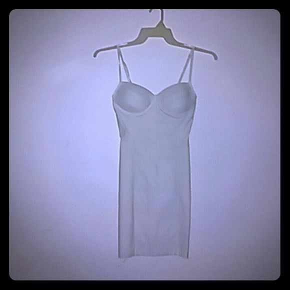 White skin tight dress White spaghetti strap dress. Skin tight. Gently used. Zipper up partially in the back. Body Central Dresses Maxi