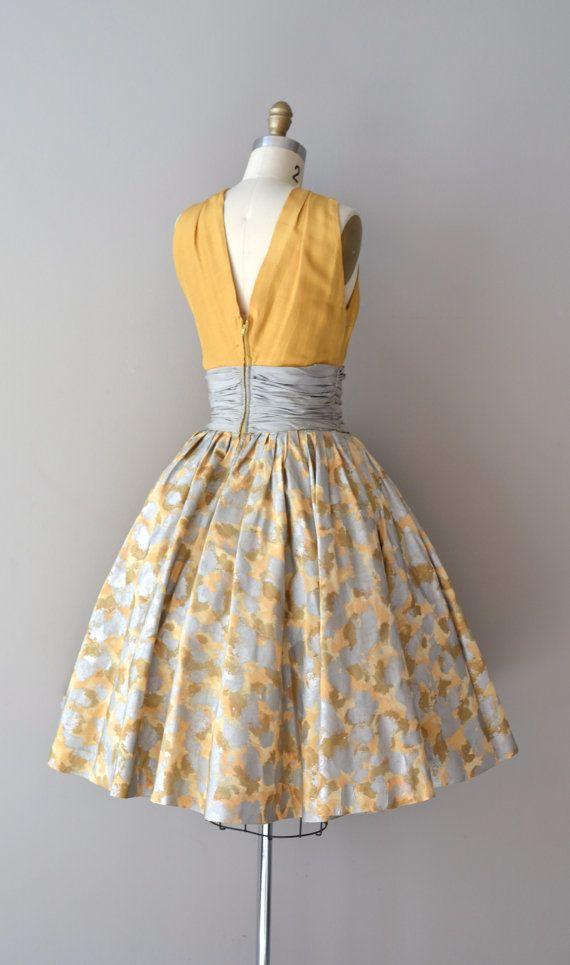 Back of 1950s Estévez silk dress with mustard silk halter bodice, wide dove gray silk cummerbund nipped waist, very full silk gray and mustard yellow abstract print skirt and metal back zipper.