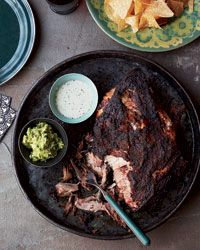Pork Shoulder Roast with Citrus Mojo and Green Sauce. Slow-roasted pork shoulder that's hugely popular in Puerto Rico and the Dominican Republic.