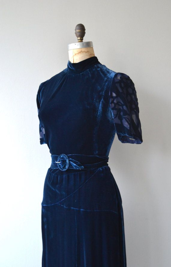 Vintage 1930s deep cobalt blue silk velvet dress with burntout short sleeves, high neckline, bias construction, matching belt and metal side closures. --- M E A S U R E M E N T S --- fits like: medium shoulder: 15 bust: 40-41 waist: 31 hip: free length: 44.5 brand/maker: n/a condition: excellent ✩ layaway is available for this item To ensure a good fit, please read the sizing guide: http://www.etsy.com/shop/DearGolden/policy ✩ more vintage dresses ✩ http...