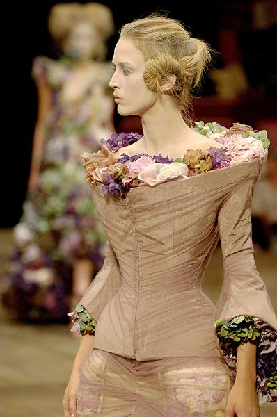 """Things rot. . . . I use flowers because they die"".     Alexander McQueen   - A scooped funnel neck festooned with fresh and silk flowers from the spring/summer 2007 Sarabande show. The show notes cited inspirations including Stanley Kubrick's 1975 film Barry Lyndon, European society figure Marchesa Luisa Casati and the artist Goya"