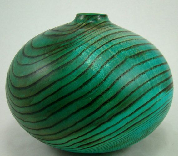 This Ash vessel was sanded then the open grain was burned, then the piece was dyed. Beautiful!
