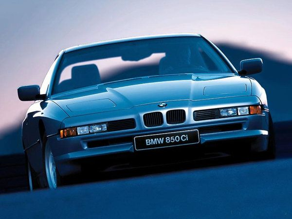 15 YRS LATER THE BMW E31 LOOKS FRESH AND FRIGHTENING AS IT DID THE DAY IT ROLLED OFF THE ASSEMBLY LINE. THE 4.0 LITER VARIANT WASN'T BAD BUT SHOULD HAVE BEEN THE 850i WITH THE M70B50 5.0 LITER V12. ESSENTIALLY THE TWO M20 OM;OME SEOXES FISED TPGETJER AT 60 DEGREES/ BUT VERY FEW PARTS FROM THE M20'S CROSS OVER TO THE M70.THE ENGINE REQUIRES INDIBUDULA ECUS FOR EACH CYLINDER BANK AND WEIGHTS IN AT 5322 LBS. STILL A BADASS LOOKING CAR BUT PERFORMANCE WISE IT WAS A BIG DISAPPOINTMENT.
