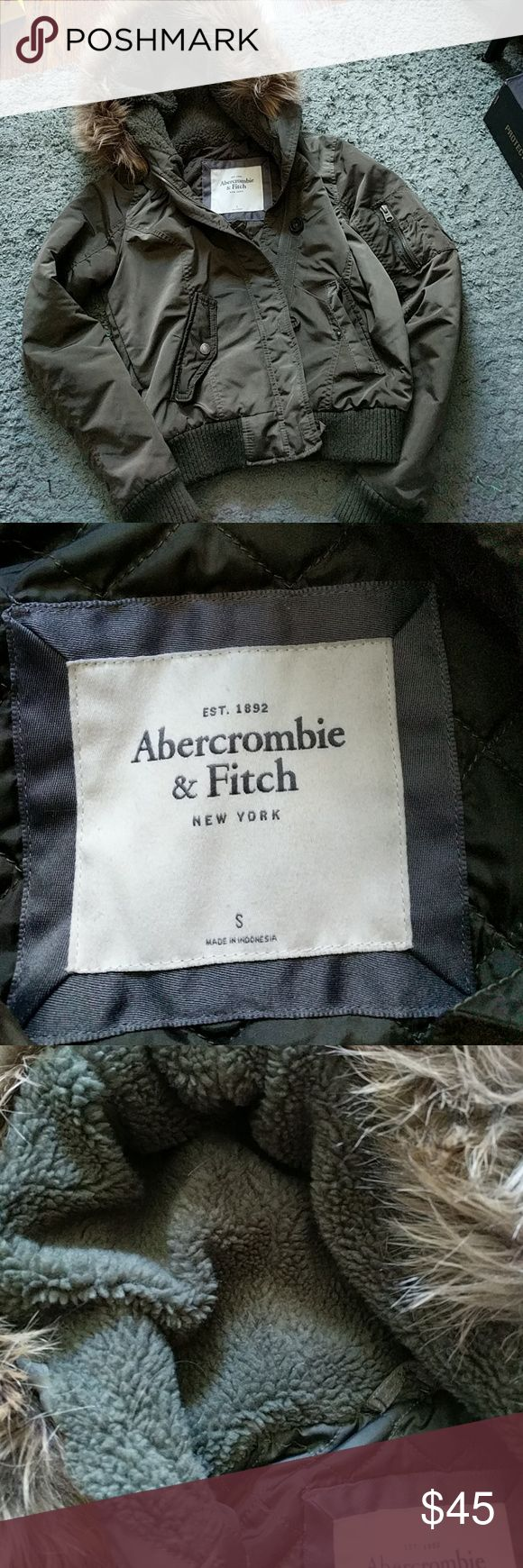 Abercrombie and Fitch Jacket Size small bomber style jacket.  Olive in color with removable fur.  Zips and buttons.  Minor piling but no stains.  Questions please feel free to contact me. Abercrombie and Fitch Jackets & Coats
