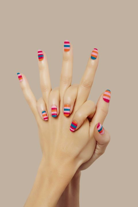 A striped rainbow mani is the perfect look for summer. Try the look with bold, 80s inspired colors.