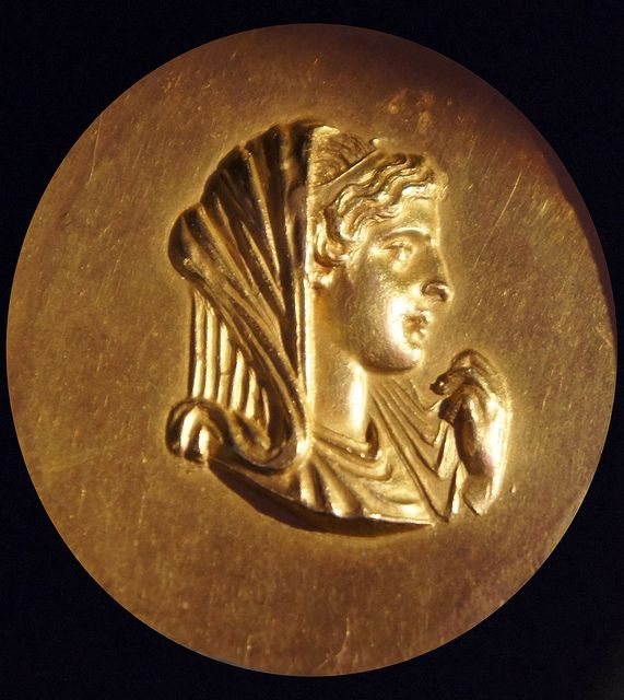Olympias on an Athletics Gold Medal, from Macedonian games at Beroea 200AD. Reverse shows a Nereid riding a sea-monster. Thessalonica Archaeological Museum