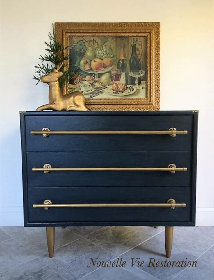 """The holidays are coming and so are the guests. This navy blue & gold chest is perfect for extra storage in your guest bedroom, or storage for linens in your dining room. This three drawer chest would make the perfect statement piece in your entryway. Don't let this one slip through your fingers. Measures 30 1/4"""" x 34"""" x 18"""". Pick up in Chester, Md or delivery available for a fee."""
