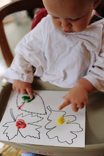 Finger painting at a young age . . . great for wall art. There is a free template to download and use for kids to finger paint.