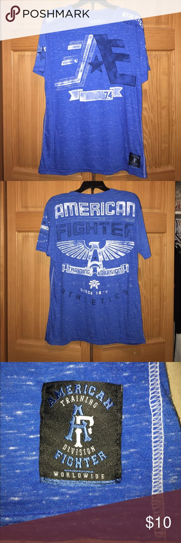 Men's American Fighter T shirt Men's American Fighter T Shirt. SIZE XL . Shirt is a heathered bright blue with white detailing. American Fighter Shirts Tees - Short Sleeve