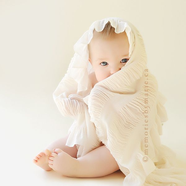 6 month photos baby wrapped in blanket