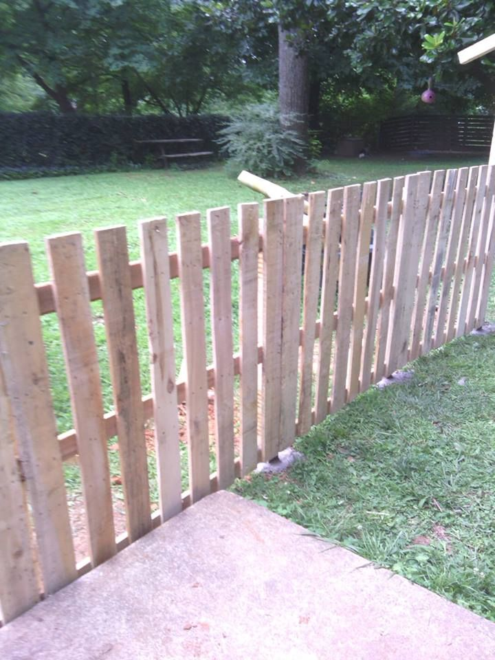 Pallet fence. Nice work. Years ago, I told my son I wanted to build a fence from pallets and he was appalled. He thought I meant just line the pallets up and be done. Oh, how times have changed. I would put a decorative design on the top of the pickets if this were mine.