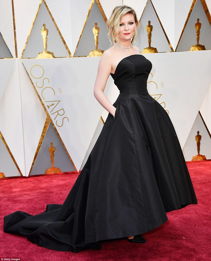 Hourglass: Kirsten Dunst's perfect figure was on show in her princess-like ballgown...