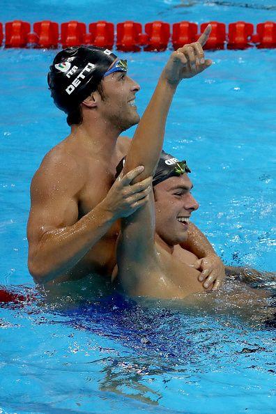 Gregorio Paltrinieri of Italy celebrates winning gold with Gabriele Detti of…