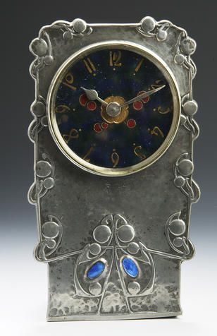A Liberty & C0. A Tudric Pewter time piece, designed by Archibald Knox   The House of Beccaria