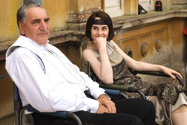 Jim Carter, who plays butler Charles Carson relaxes with Michelle Dockery, aka Lady Mary Crawley