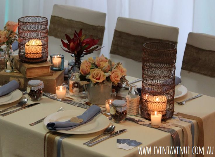 Our rustic vintage wedding centerpiece with chocolate and duck egg blue colour theme