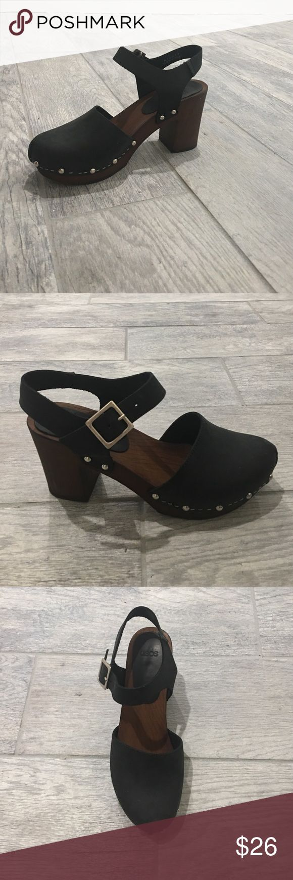 Black heeled clogs ASOS brand clogs. Just purchased this season, they're a little wide so if you wear a 7, they'll be closer to a 7.5 women's. They're adorable and not too tall! ASOS Shoes Mules & Clogs