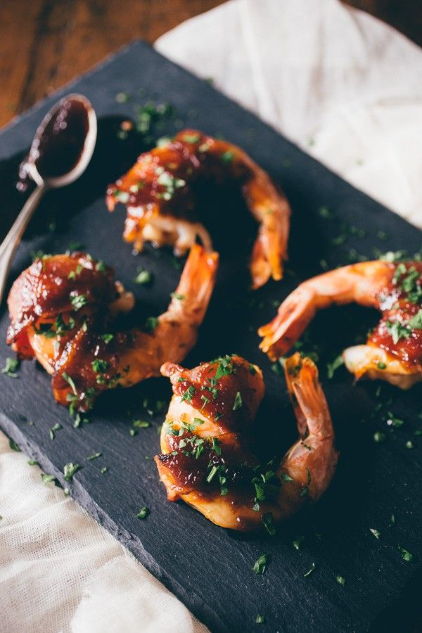 These apple butter bacon wrapped shrimp are the perfect summer appetizer. Extra large shrimp wrapped in bacon and glazed with a sweet and spicy apple butter glaze.