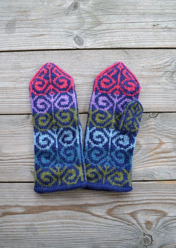 Hand-knit wool mittens are colored like the northern lights.