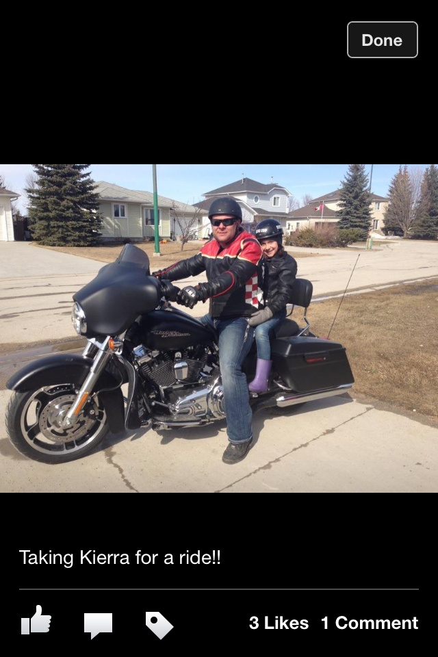My 2013 street glide with my daughter