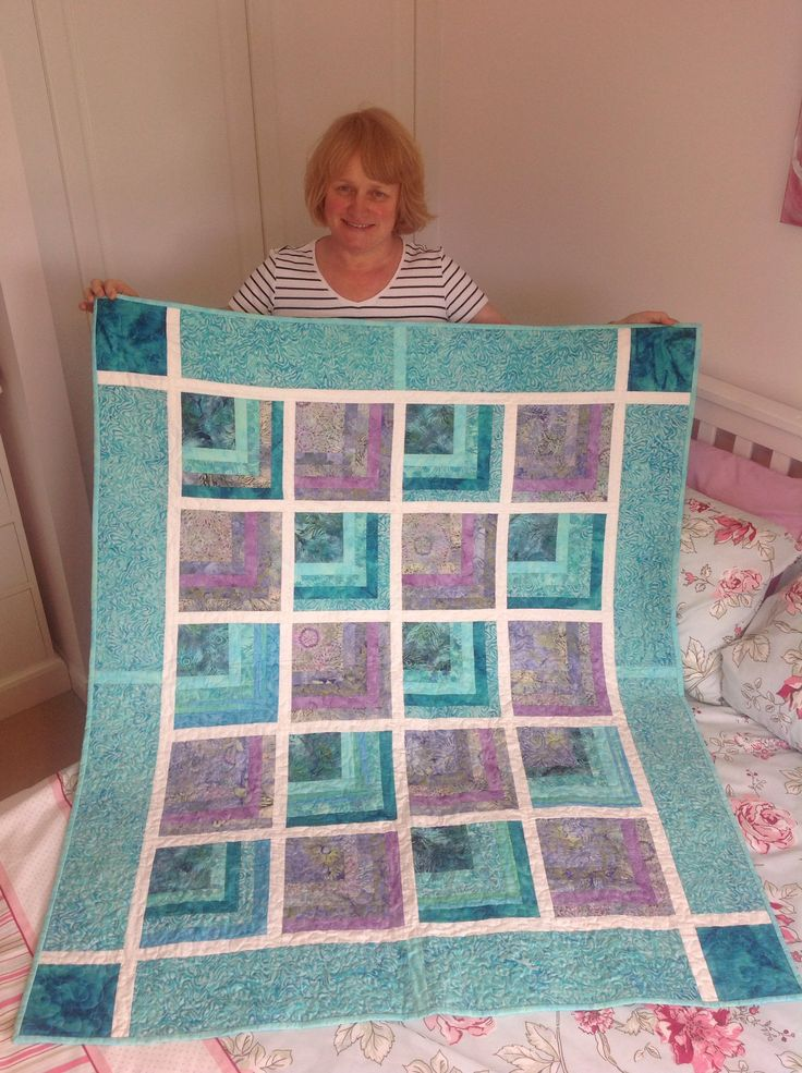 Quilt. Sort of a half log cabin pattern, great fun to make.  My lap quilt! Saves on the central heating no end!!